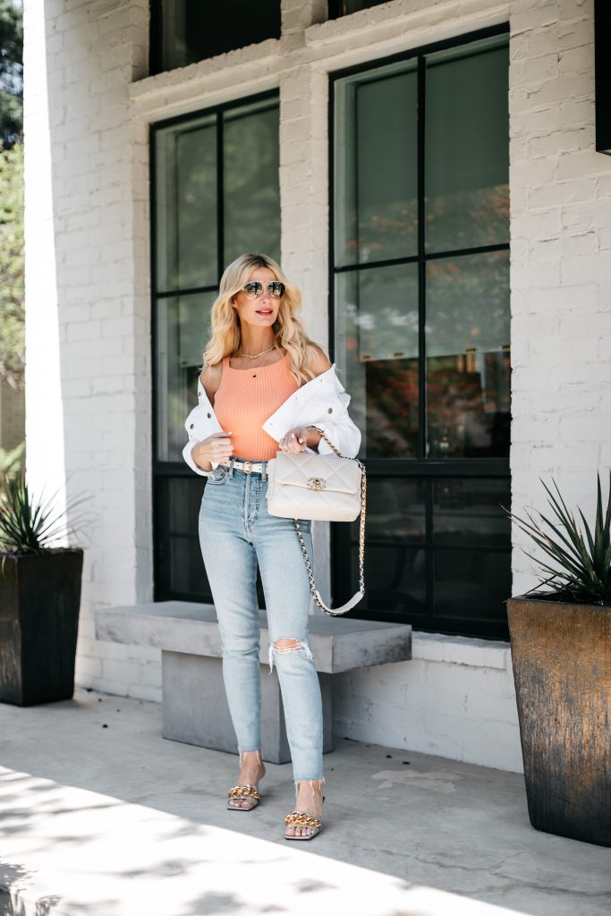 Dallas style blogger wearing a white denim jacket and gold sandals for summer