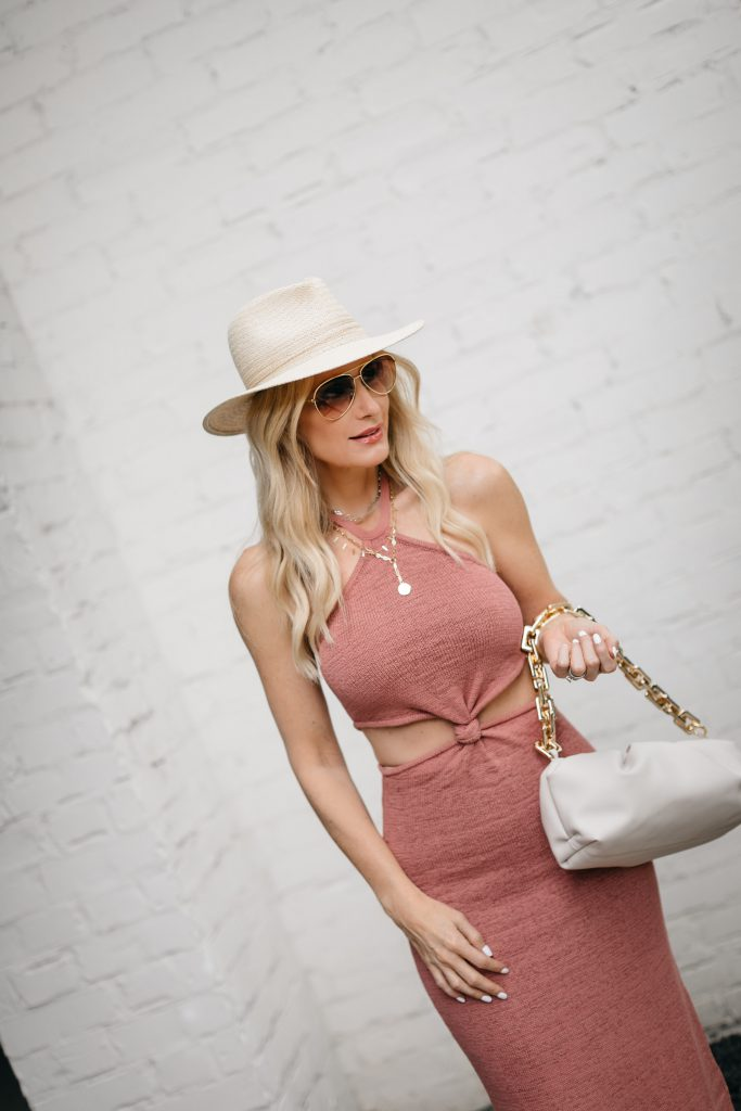 Dallas fashion blogger wearing a neutral summer hat and a rose colored cut out dress