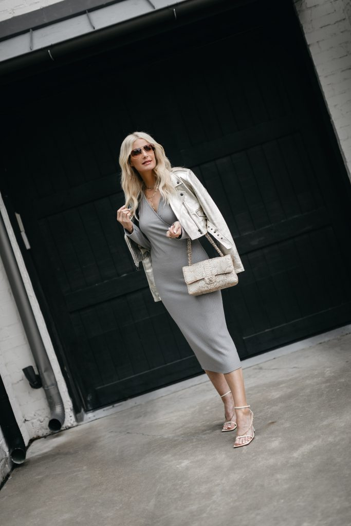 So Heather Blog wearing a gray dress and a faux leather Moto jacket