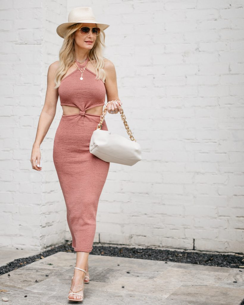Dallas fashion blogger wearing a pink cut out dress and a beige hat for summer