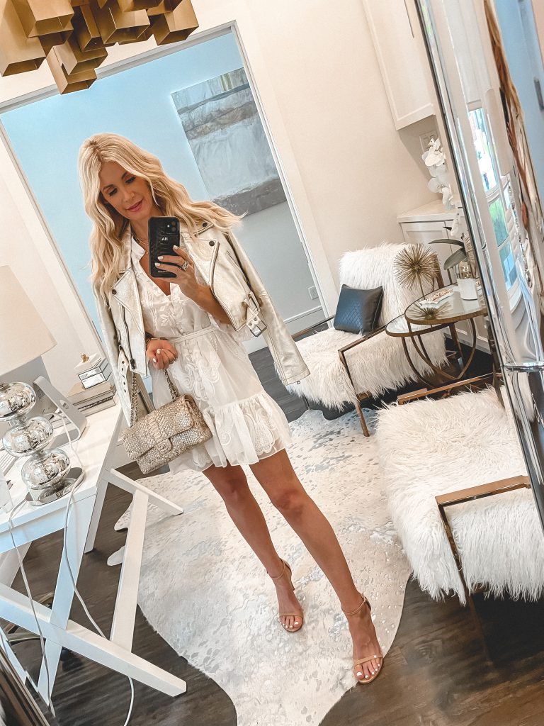 Dallas fashion blogger wearing a white summer dress paired with a faux leather white jacket