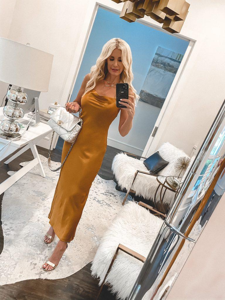 Dallas fashion blogger wearing a marigold silk dress with gold heels