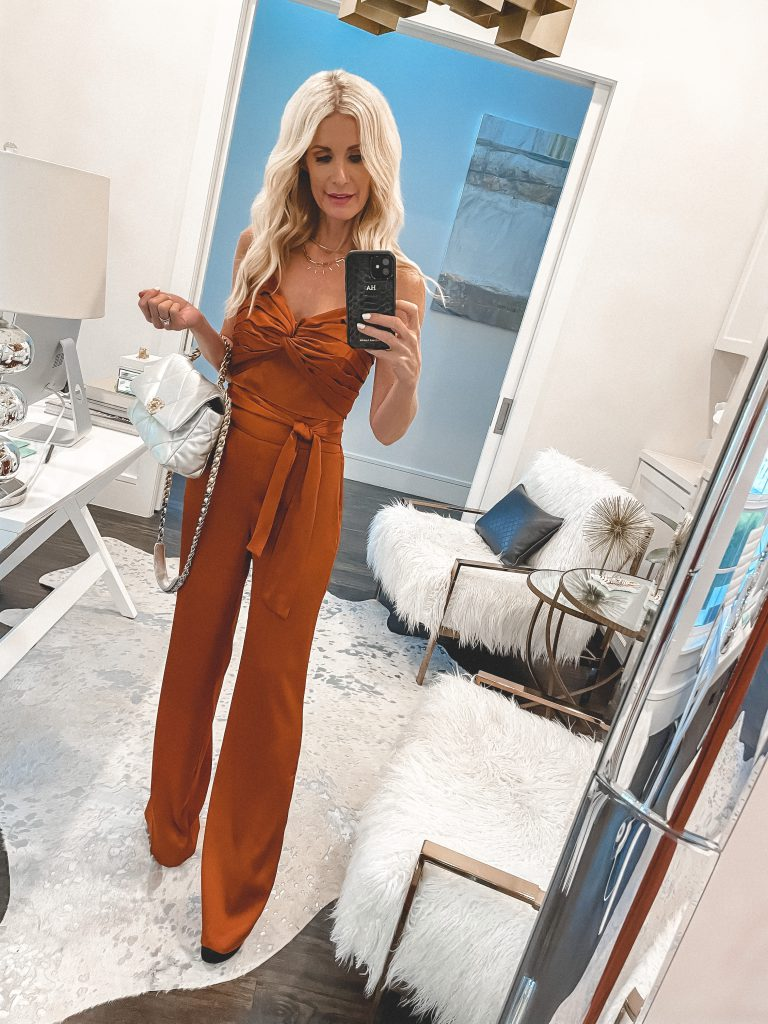 So Heather fashion blogger wearing an orange jumpsuit for spring and summer