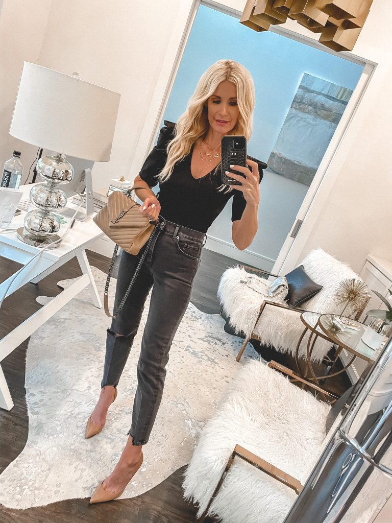 Dallas style blogger wearing a black bodysuit with puff sleeves and black denim