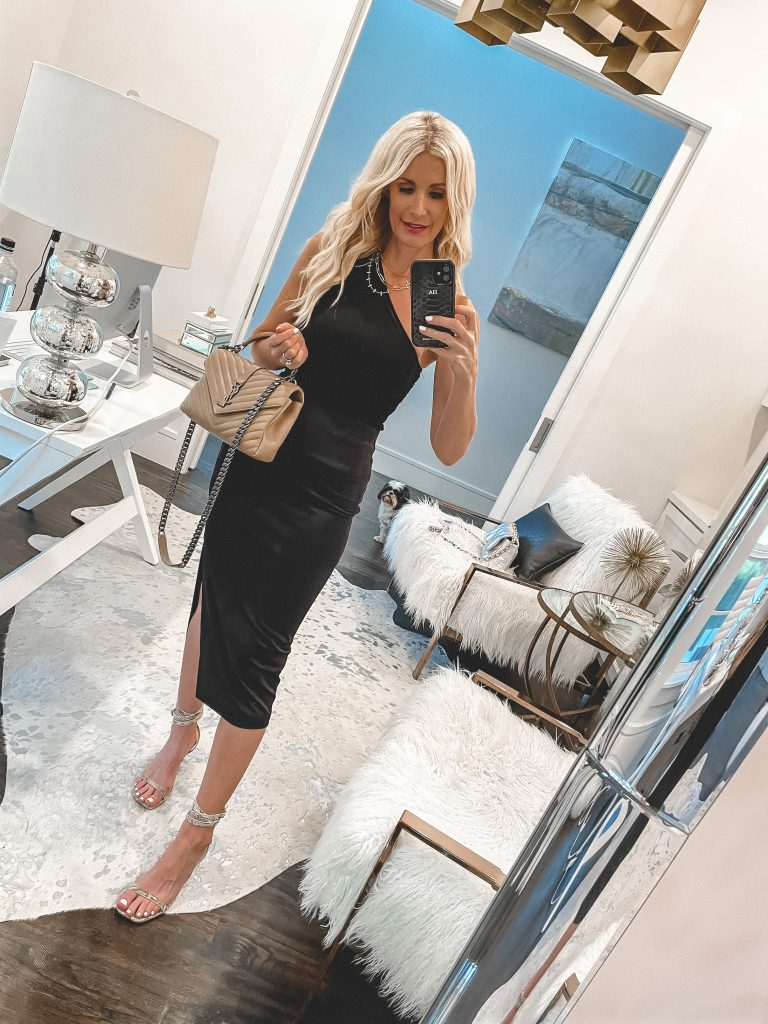 Dallas blogger wearing a black one-shoulder top and a skirt and heels for date night