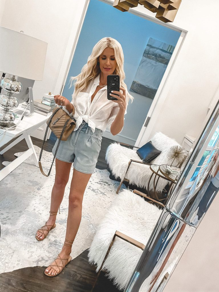 Dallas blogger So Heather Blog wearing a white top from Express and denim shorts
