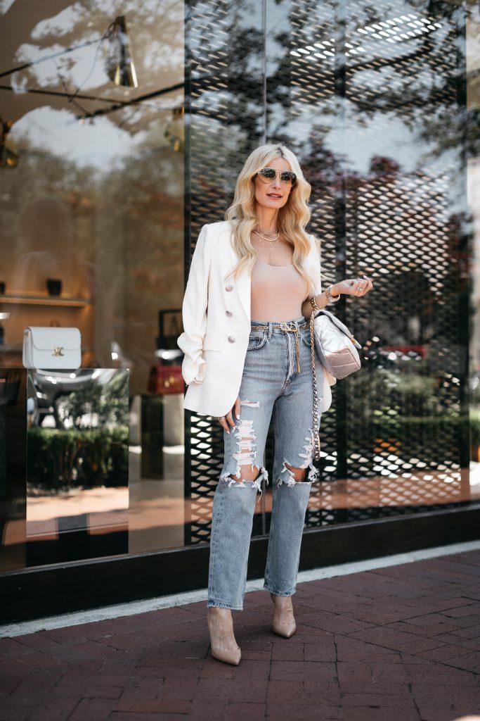 Dallas fashion blogger wearing distressed denim and a white blazer