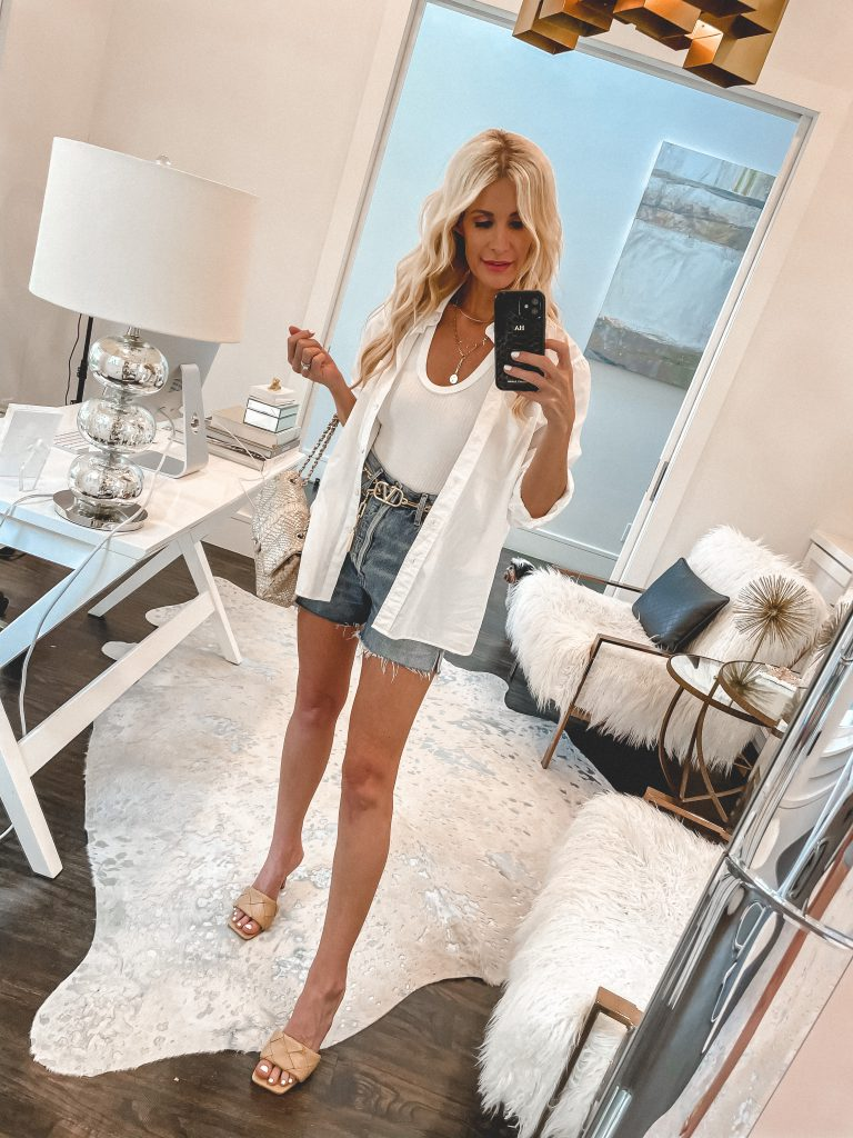 Dallas fashion blogger wearing denim shorts and a white top for summer