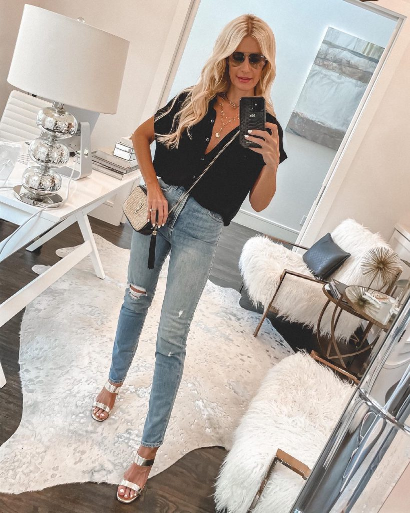 So Heather Blog wearing a black short-sleeve top and denim for summer