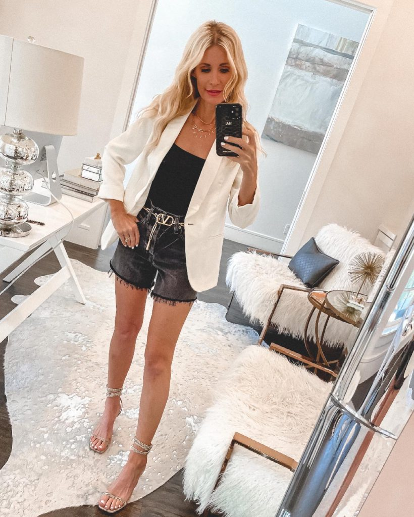 Dallas style blogger wearing agolde black shorts and a white blazer