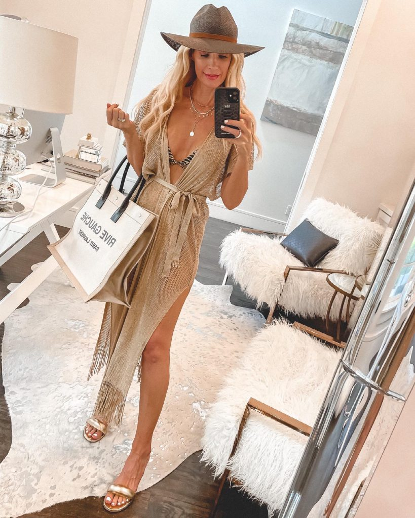 Dallas blogger wearing a wrap cover-up and a neutral straw hat