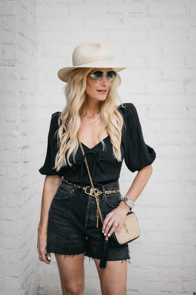 Dallas fashion blogger wearing a black puff sleeve top and black denim shorts for summer