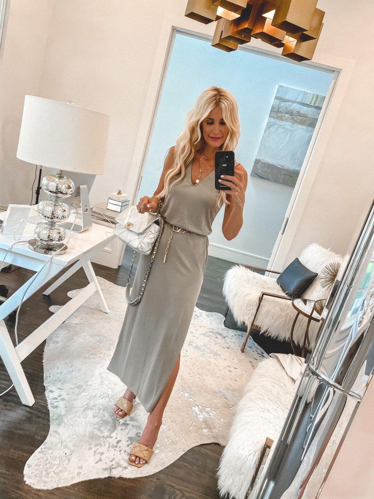 Dallas blogger wearing a long grey maxi dress and tan block heels