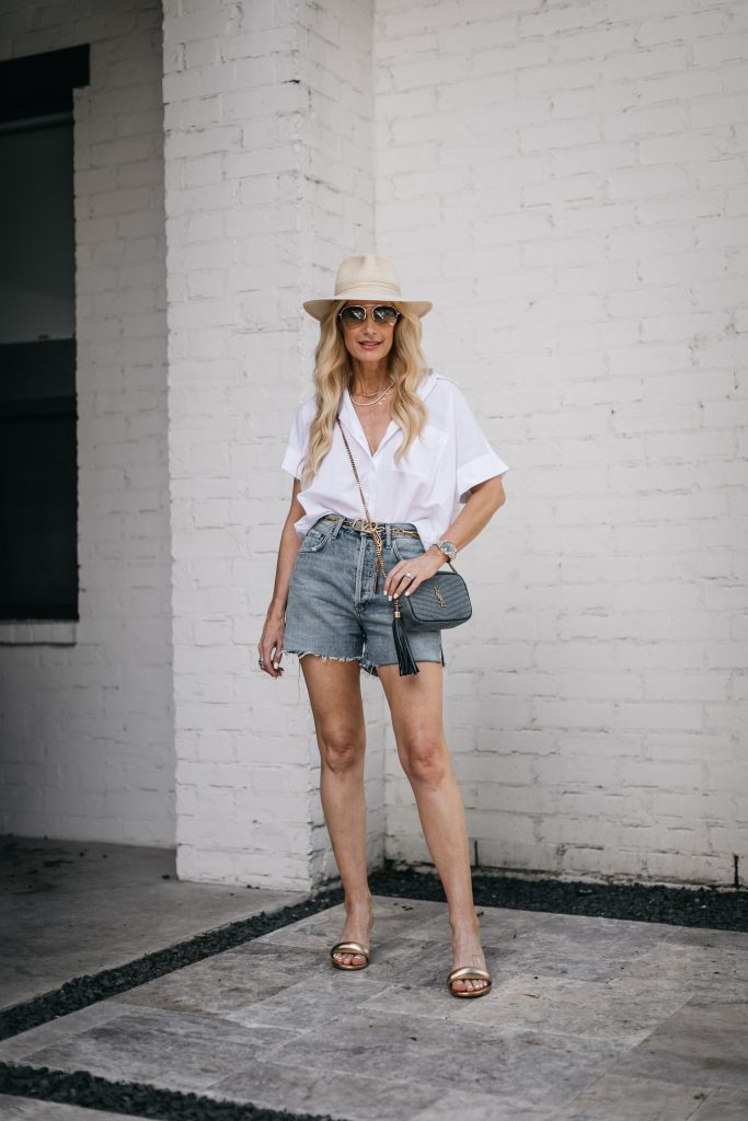 Dallas blogger wearing denim shorts and a white button-down
