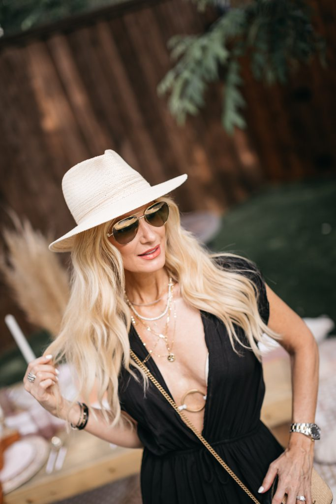 Dallas blogger wearing a black swimsuit cover-up
