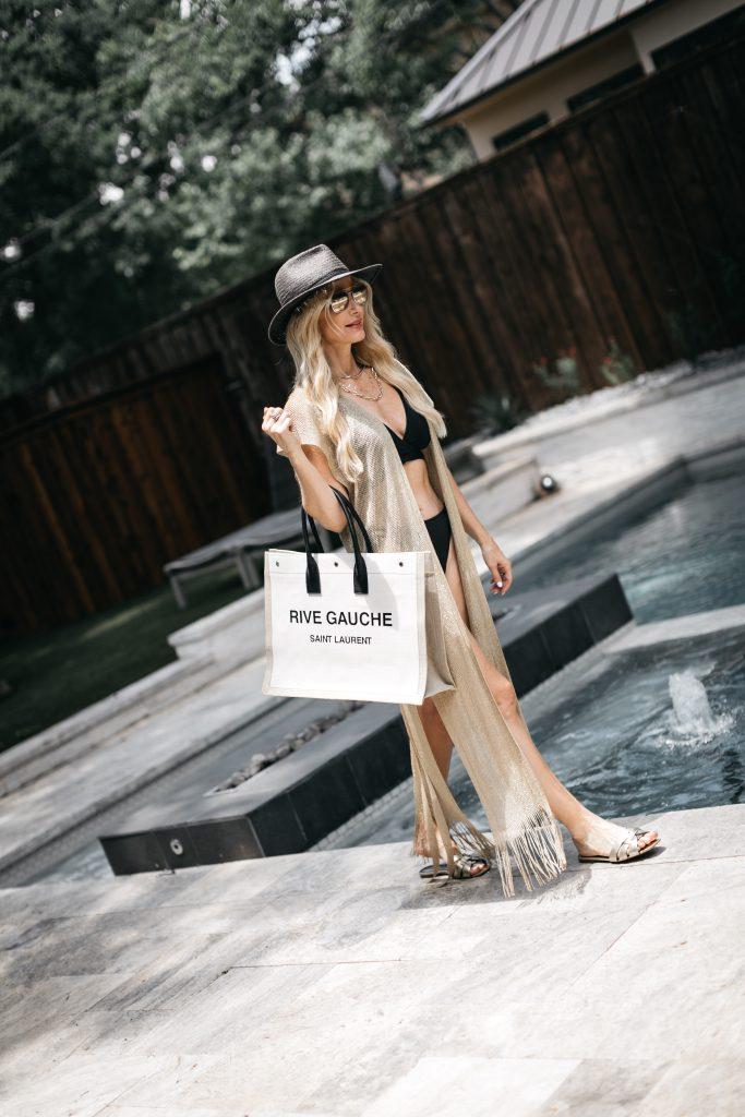 Dallas blogger wearing a neutral cover-up and a black bikini