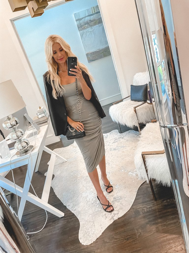 Dallas blogger wearing a black blazer and a grey ruched skirt