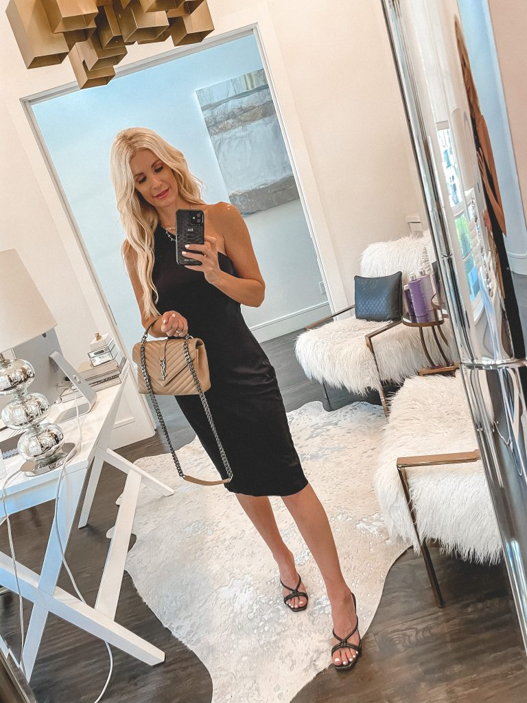 Dallas blogger wearing a one-shoulder black dress and a neutral YSL bag
