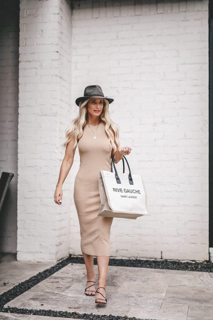 So Heather Blog wearing a light tan midi dress and a Rive Gauche handbag