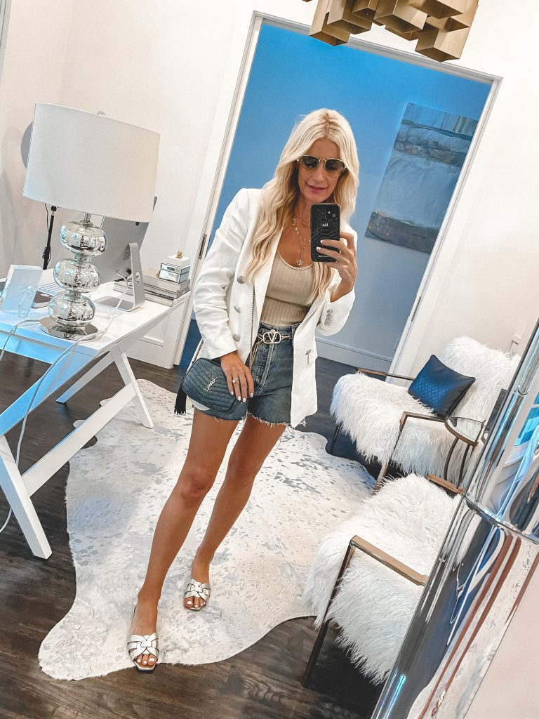 Dallas blogger wearing a white blazer and gold sandals