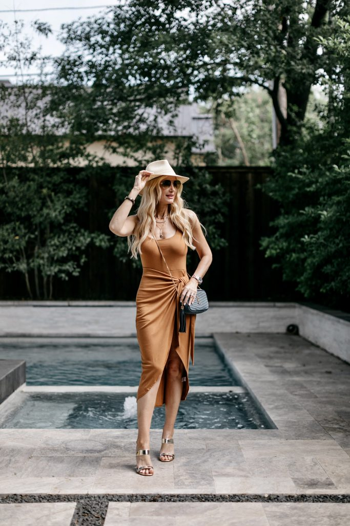 Dallas blogger wearing a chic summer dress and gold heels