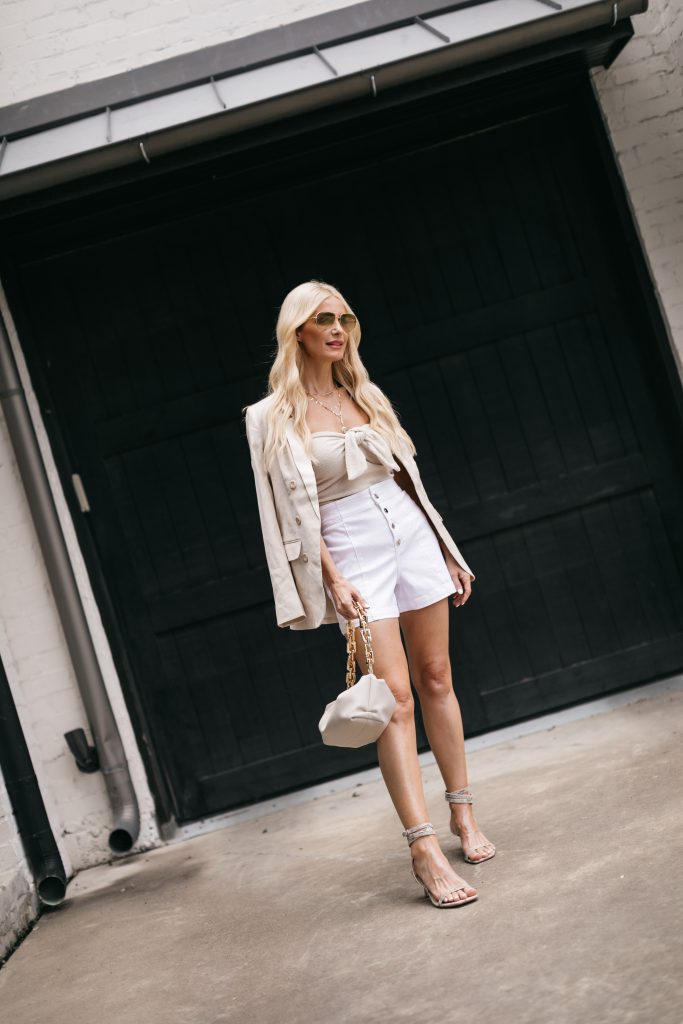 Dallas blogger wearing white shorts and a neutral blazer