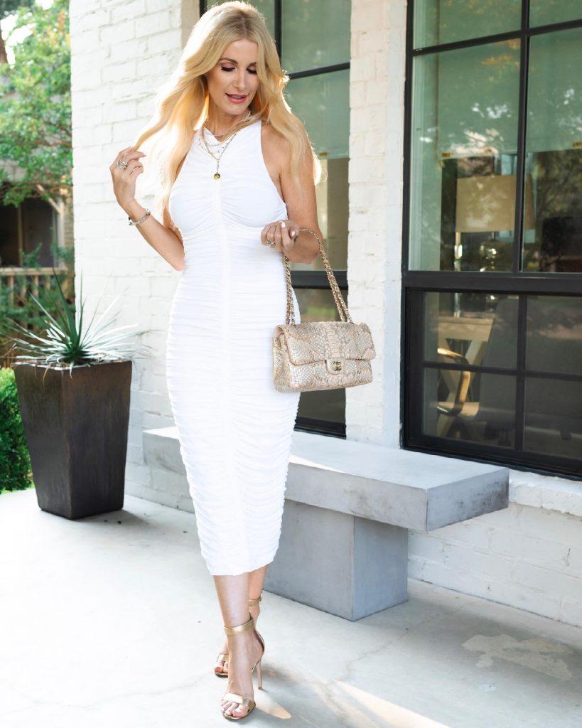 Dallas blogger So Heather Blog wearing a white midi dress and a snake print handbag
