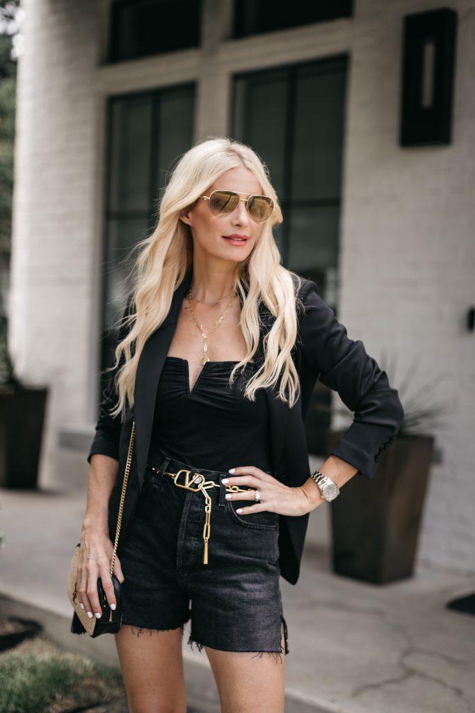Dallas blogger wearing a black blazer and black denim shorts