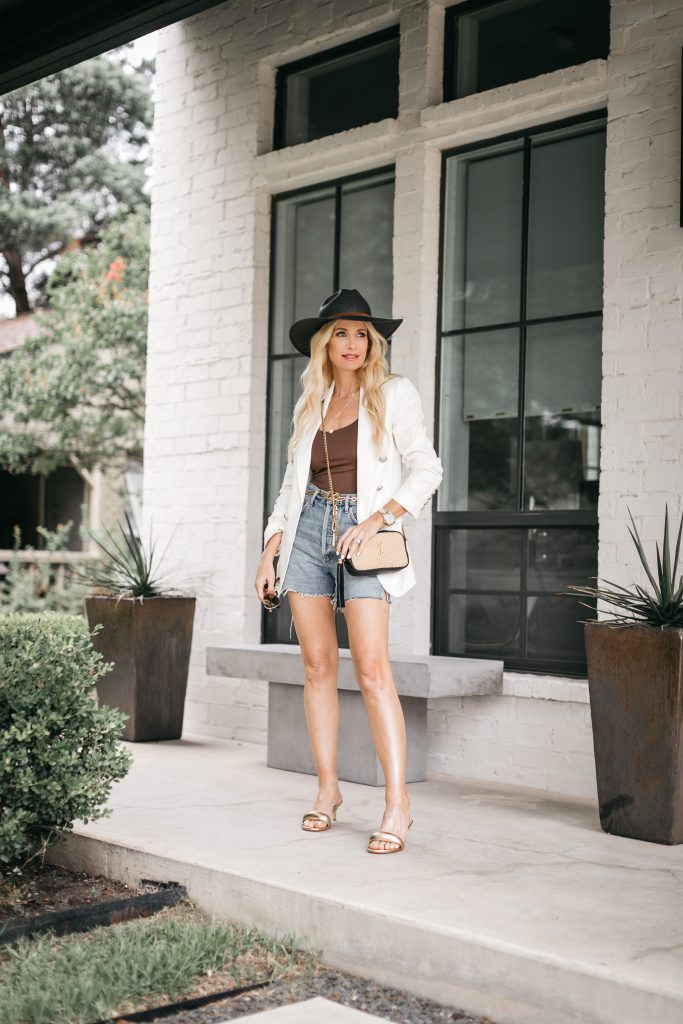 Dallas blogger wearing a white blazer and a black hat for summer