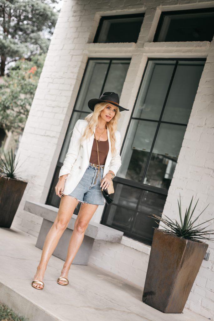 Dallas blogger wearing a white blazer and a brown bodysuit