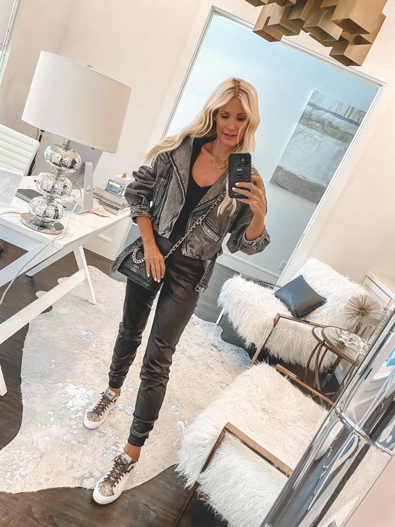 Dallas style blogger wearing a black denim jacket and a faux leather leggings