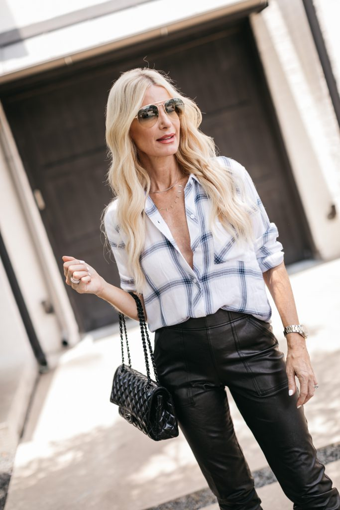Dallas blogger wearing a blue and white button down and a black handbag