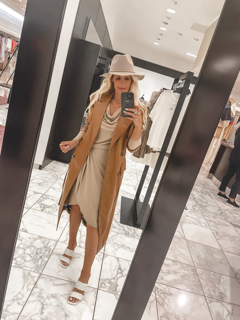 So Heather Blog wearing a long leather jacket and a neutral colored dress