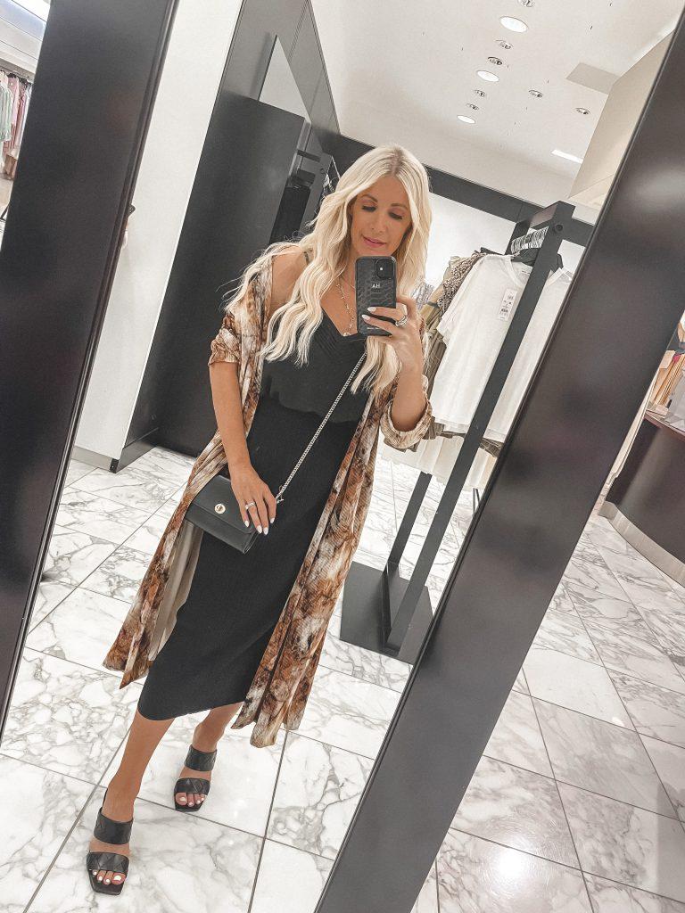 Dallas style blogger wearing a snake print kimono and a black dress