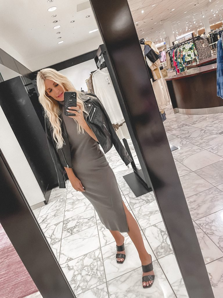 Dallas blogger wearing a grey midi dress and a black moto jacket