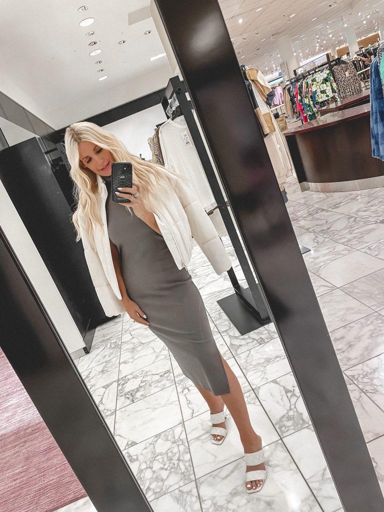 Dallas fashion blogger wearing a white coat and a grey midi dress