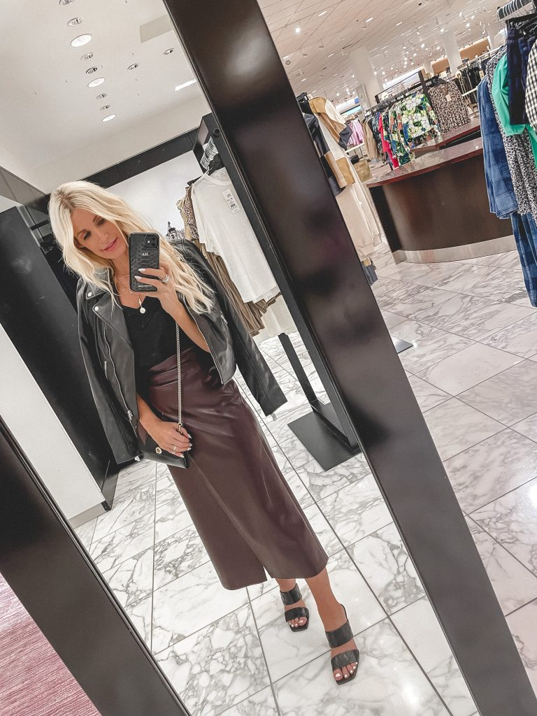 Dallas fashion blogger wearing a maroon leather skirt and a black real leather jacket