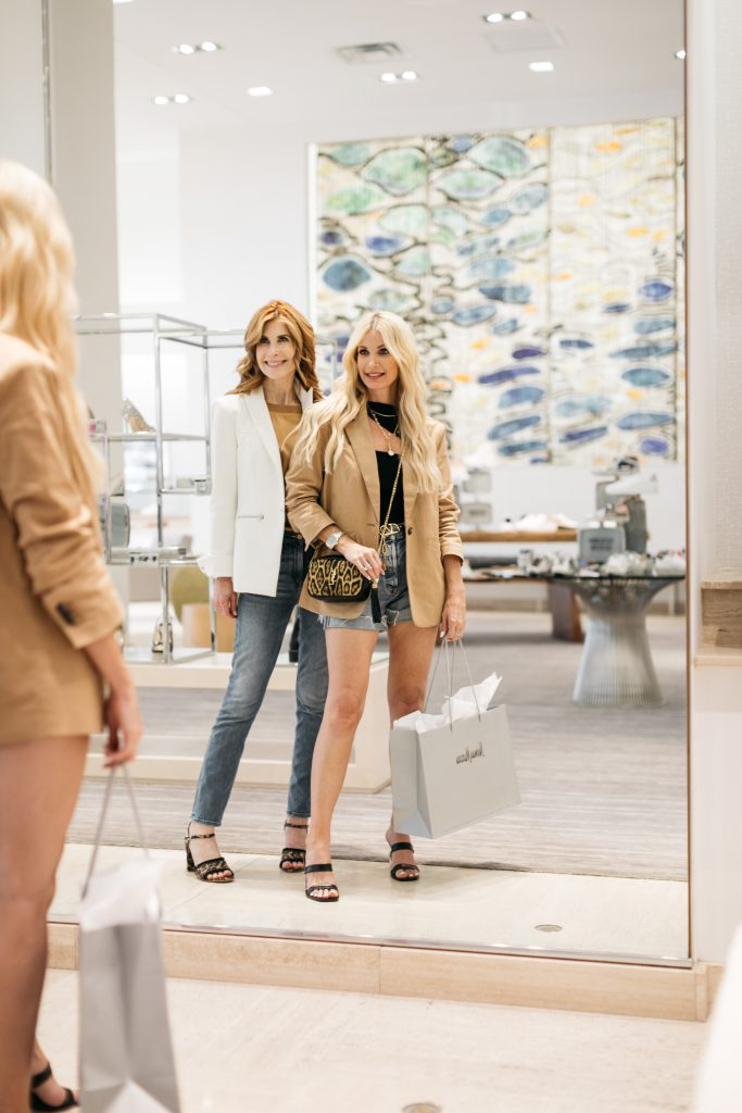 Style bloggers shopping at Neiman and wearing a blazer in the summer