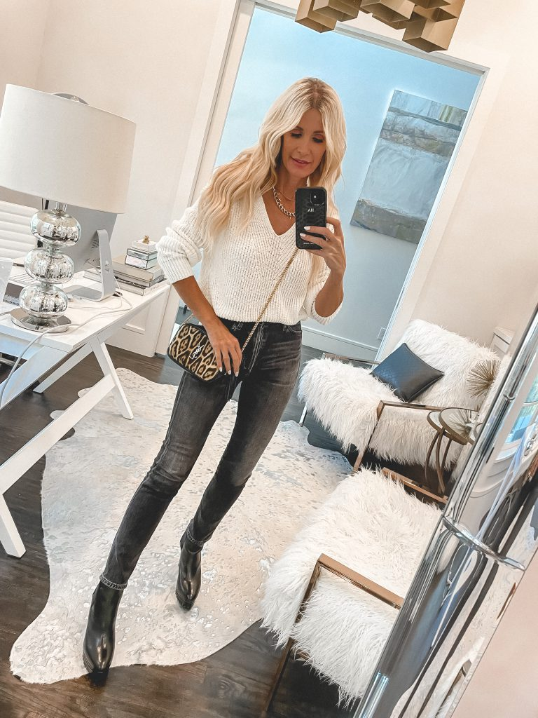 so Heather Blog wearing a white Madewell sweater and black denim from the NSALE