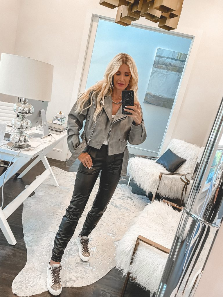 Dallas Fashion Blogger wearing a grey leather jacket and faux leather joggers