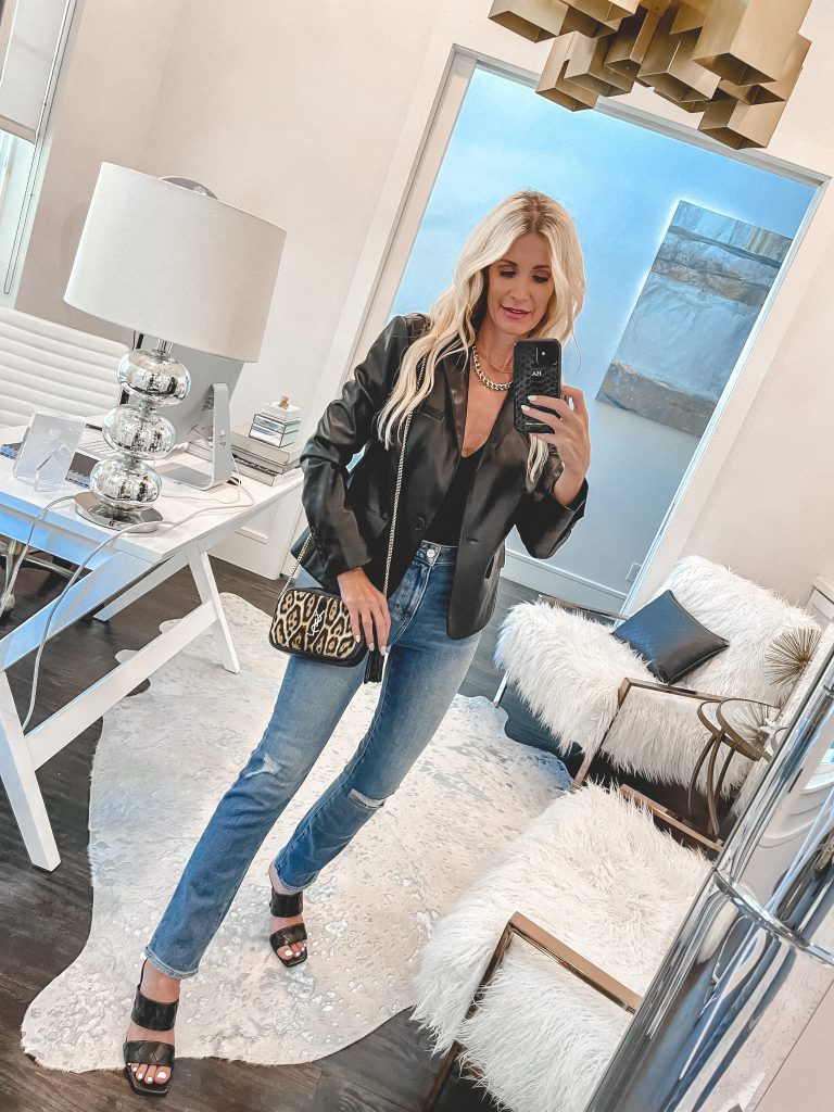 Dallas style blogger wearing a faux leather blazer and light wash denim