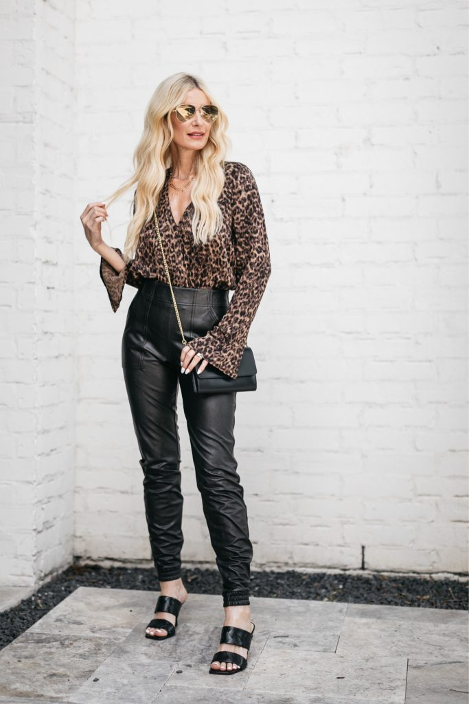 Dallas blogger wearing a leopard print bodysuit and faux leather joggers