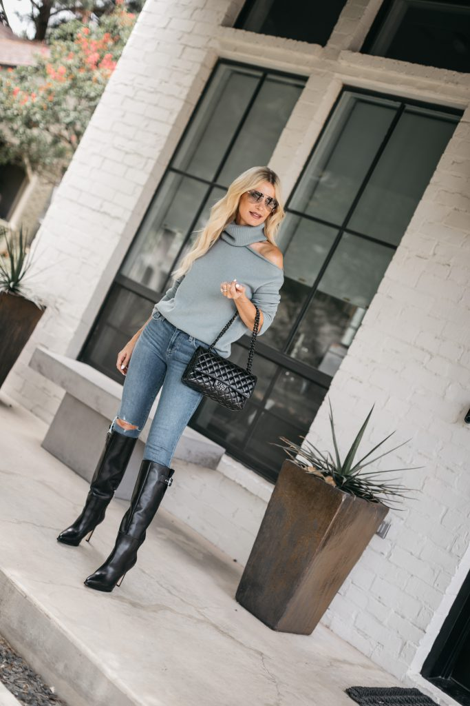 Dallas Fashion Blogger wearing a light blue cut out sweater and knee high boots