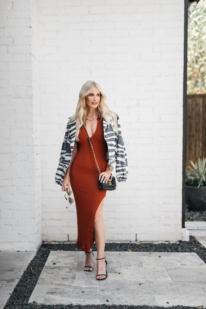Dallas fashion blogger wearing an orange Dress and a zebra jacket from revolve