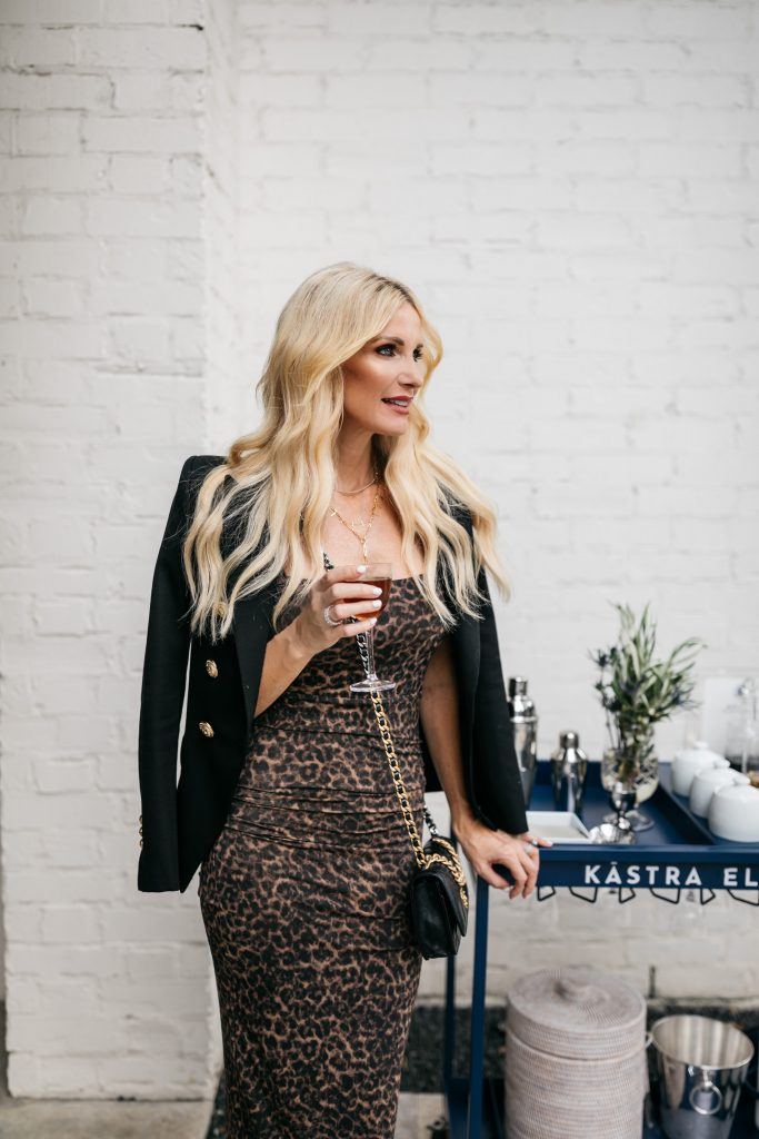 Dallas blogger wearing a leopard print dress and a black blazer with gold buttons