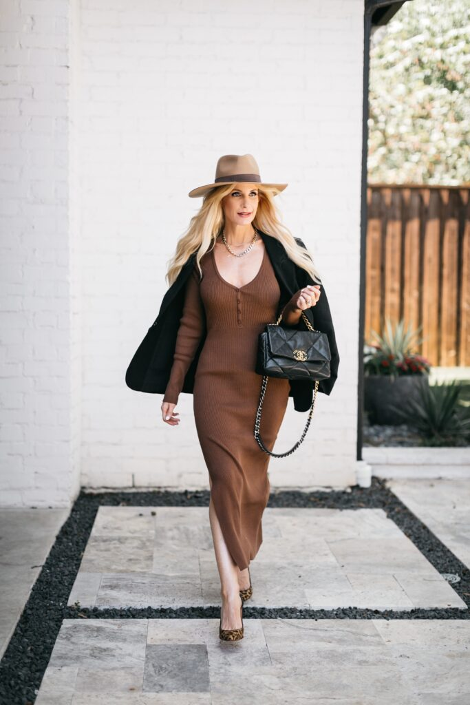 Dallas blogger wearing a brown ribbed dress and a black blazer for fall