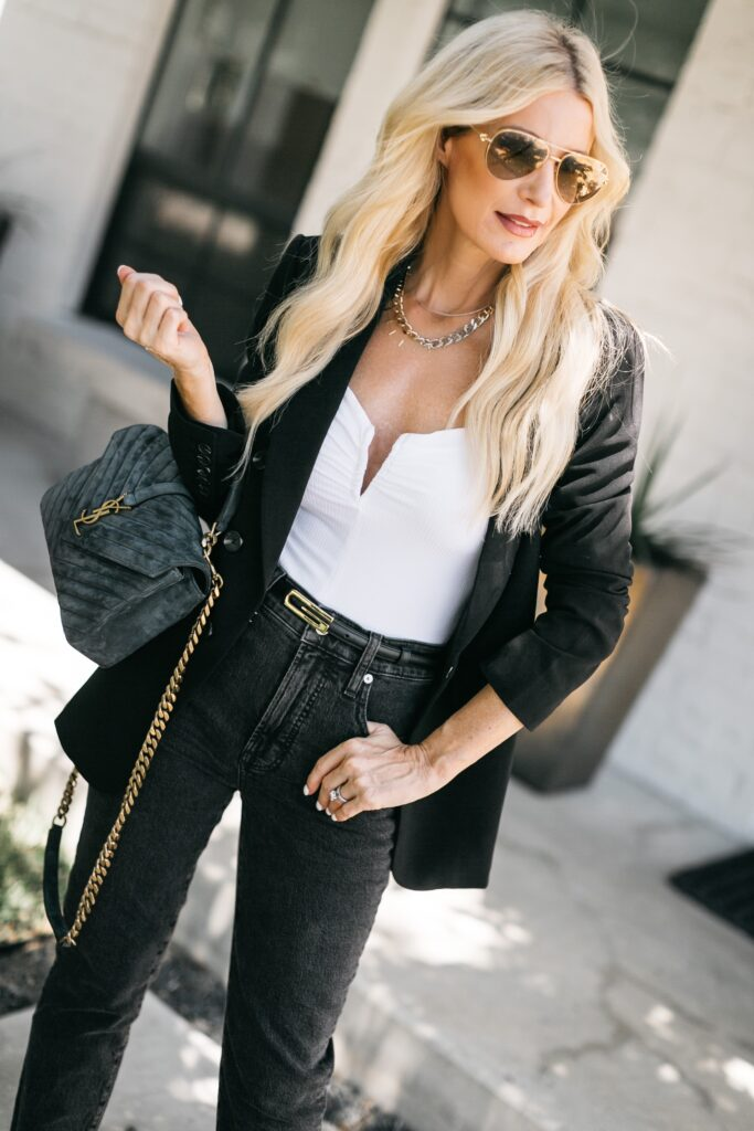 Dallas style blogger wearing a white bodysuit and a black blazer