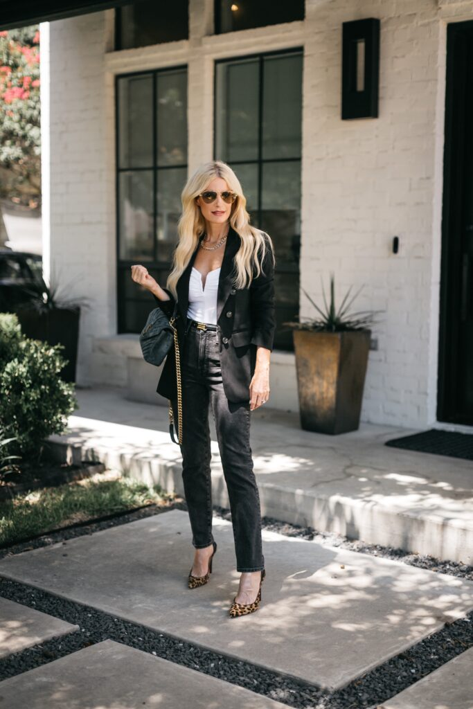 Dallas blogger wearing a black blazer and black denim