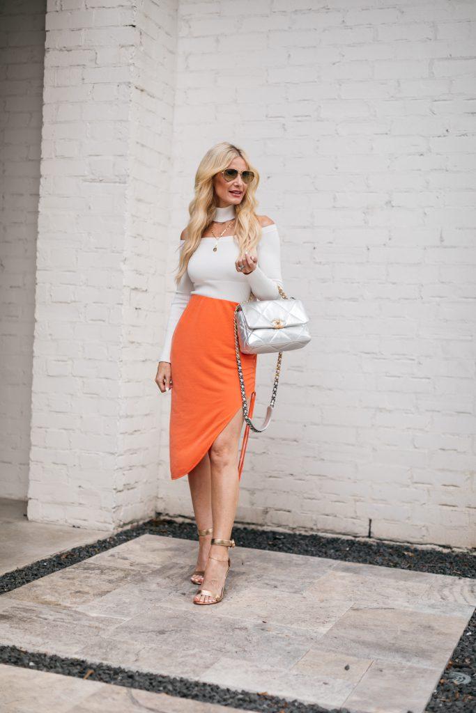 Dallas Fashion Blogger wearing an orange versatile midi skirt