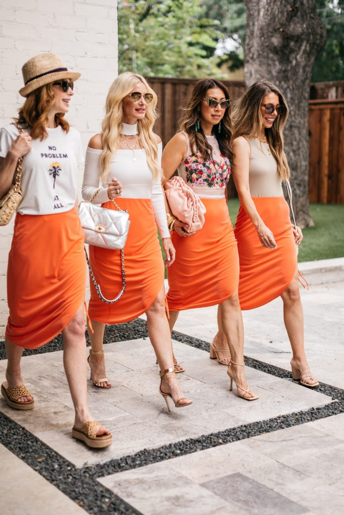 Dallas style bloggers wearing an orange midi skirt styled 4 ways for summer
